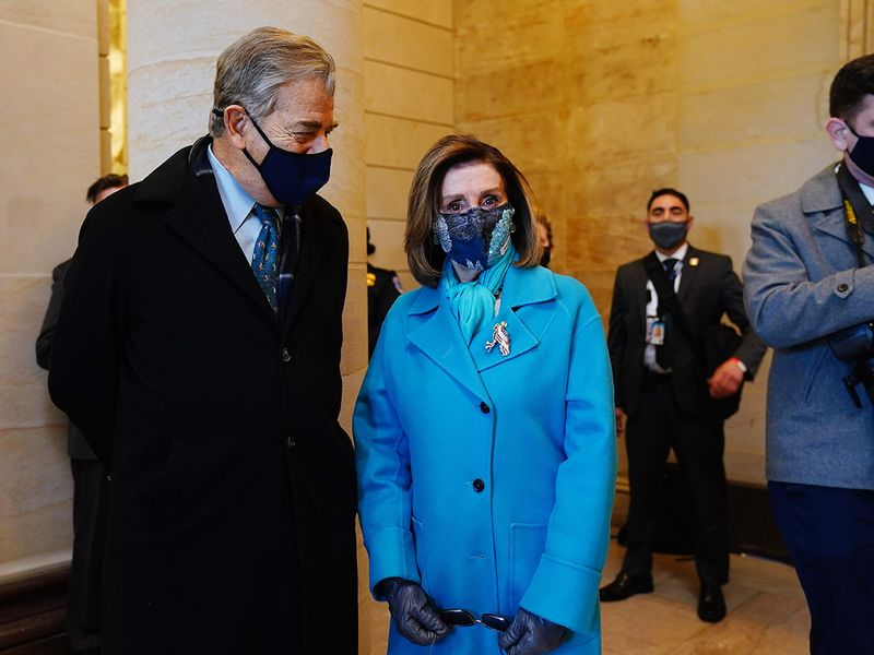 US Speaker of the House Nancy Pelosi (R) arrives for the inauguration of Joe Biden, at the US Capitol in Washington, DC.