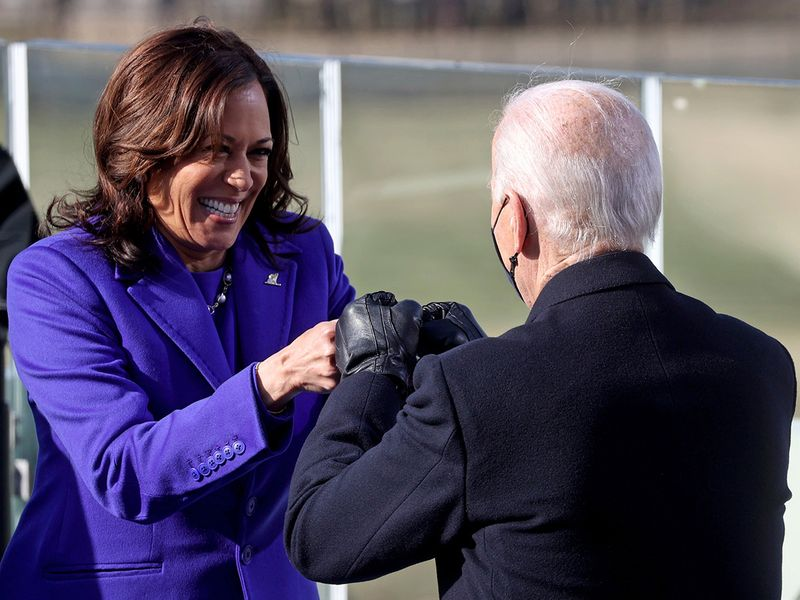 Vice President Kamala Harris bumps fists with Joe Biden after she was sworn in during the inauguration, at the US Capitol in Washington.