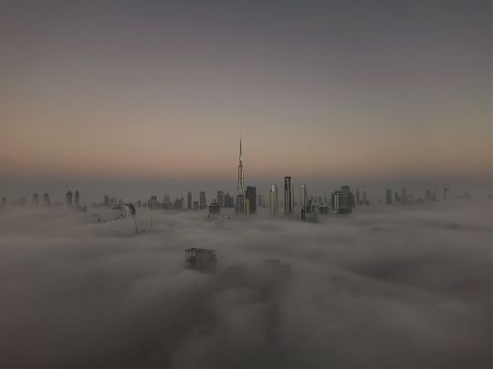 A view of the fog-covered Dubai skyline with Burj Khalifa in the background, from Damac Towers by Paramount Hotels
