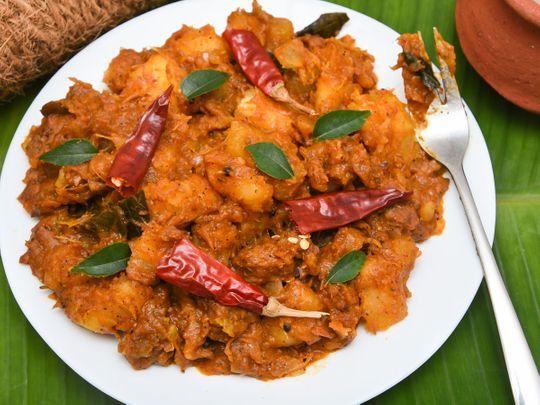 Ellum Kappayum (cassava cooked with spicy, curried beef ribs) Some call it Kappayum irachiyum, others call it Kappa Biriyani