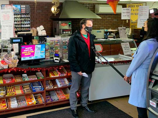 Customers being interviewed at the Coney Market in Lonaconing Md., Thursday, Jan. 21, 2021, where a jackpot-winning Powerball ticket worth $731 million was sold this week.