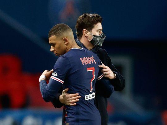 Kylian Mbappe with Paris St-Germain boss Mauricio Pochettino