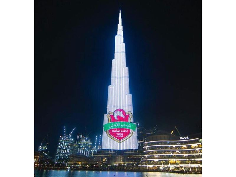 The Shabab Al Ahli Dubai colours lit up Downtown Dubai on Friday night
