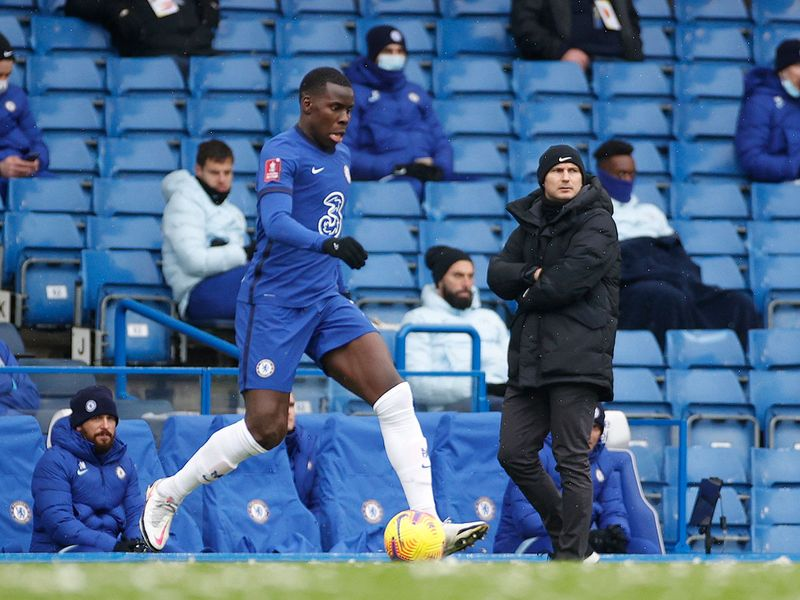 Chelsea's Kurt Zouma in action as Chelsea manager Frank Lampard looks on