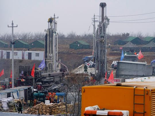 Rescuers work at the Hushan gold mine where workers were trapped underground after the Jauary 10 explosion, in Qixia, Shandong province.