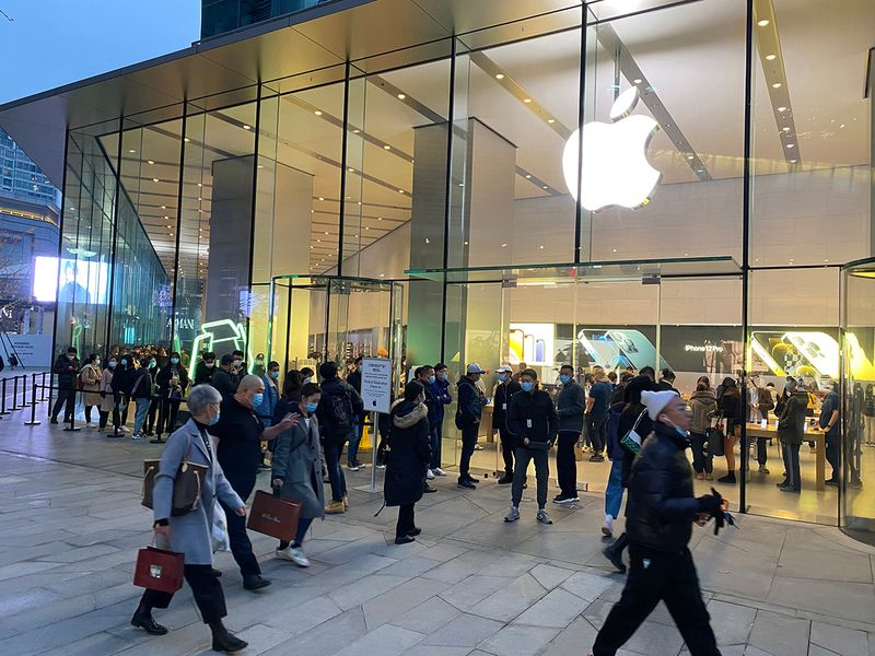 Apple profit soars as revenue tops $100b for first time
