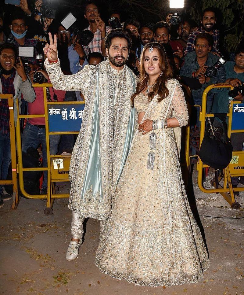 Varun Dhawan and Natasha Dalal with the press