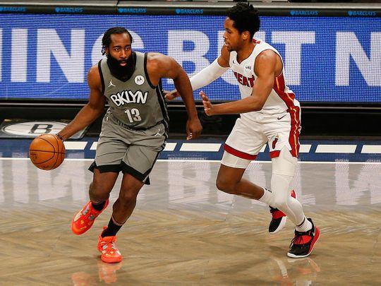 Brooklyn Nets guard James Harden and Miami Heat forward KZ Okpala
