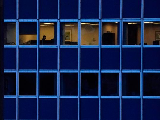 Employees work in an office building  in Midtown New York City.