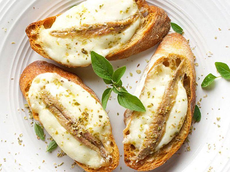 Tapas anchovies on mozzarella toasts
