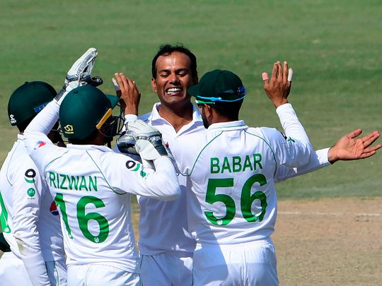 Pakistan's Nauman Ali celebrates with teammates after taking the wicket of South Africa's Anrich Nortje