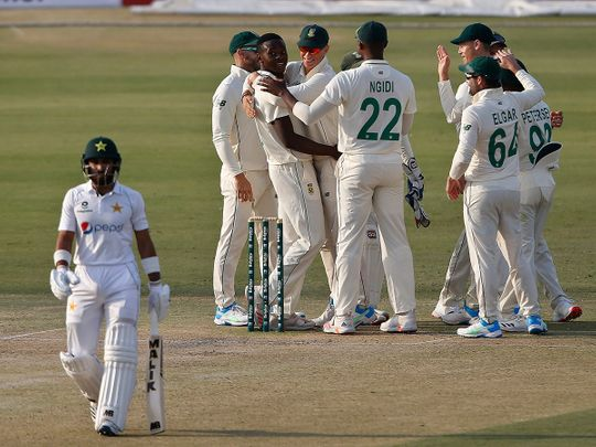 South Africa pacer Kagiso Rabada celebrates with teammates after taking the wicket of Pakistan batsman Imran Butt