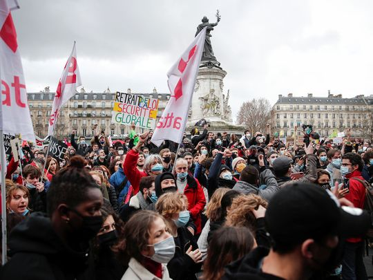 People attend a demonstration against the 'Global Security Bill'