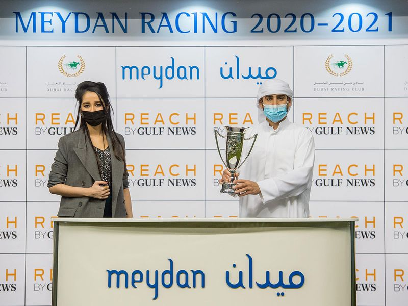 Sameera Mohammed, Gulf News Account Group Manager, presents Salem bin Ghadayer with the trophy after the Reach by Gulf News Handicap