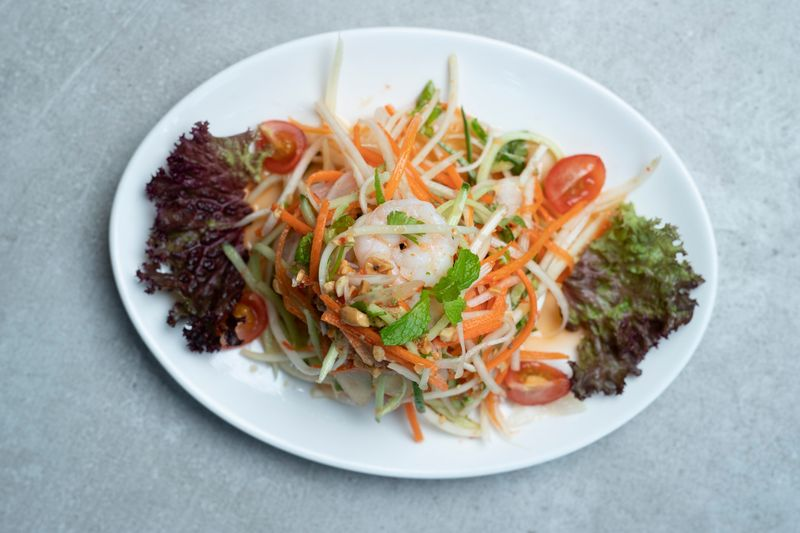 Vietnamese Goi Du Du Tom or green papaya and prawn salad