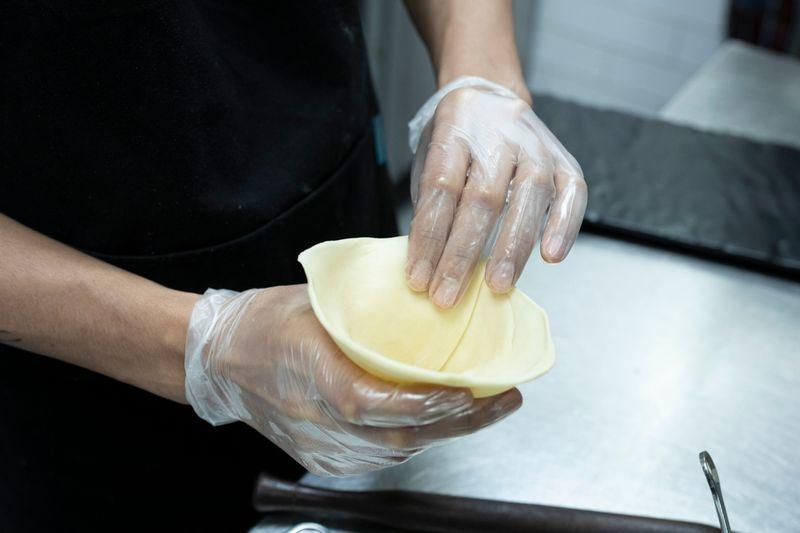 Fold into a cone-like shape.