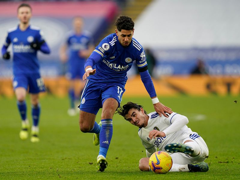 Leicester's Ayoze Perez, left, duels for the ball with Leeds United's Pascal Struijk.
