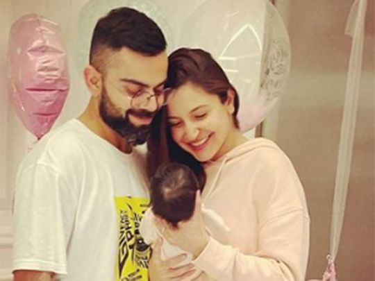 Virat Kohli and Anushka Sharma with baby Vamika