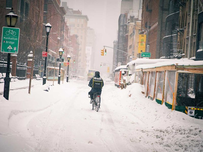 Bicycle food delivery New York snow Soho Manhattan