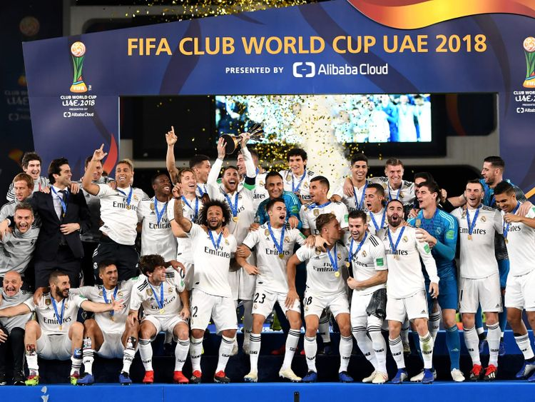 Real Madrid celebrate the 2018 Club World Cup trophy.