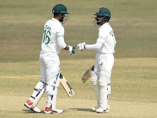 Bangladesh's Liton Das with his captain Mominul Haque during the fourth day of the first cricket Test match between against West Indies