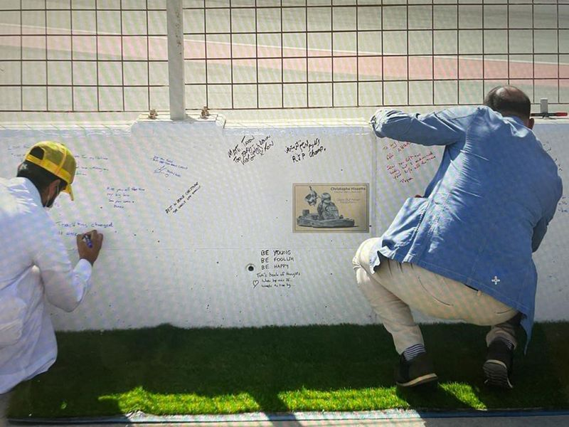 Fans and friends left messages for Christophe Hissette beside the plaque at Dubai Autodrome