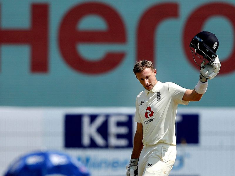 Joe Root celebrates his double century against India