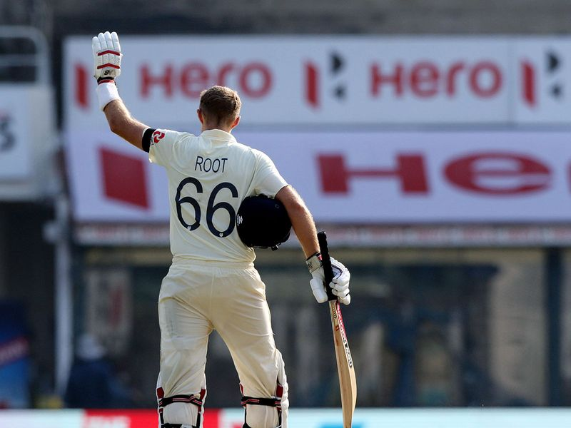 Joe Root celebrates his double century against India
