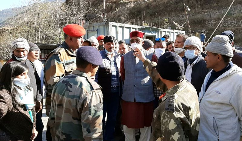 Uttarakhand Chief Minister Trivendra Singh Rawat being briefed on the flood situation by Army and ITBP jawans, in Chamoli on Sunday.