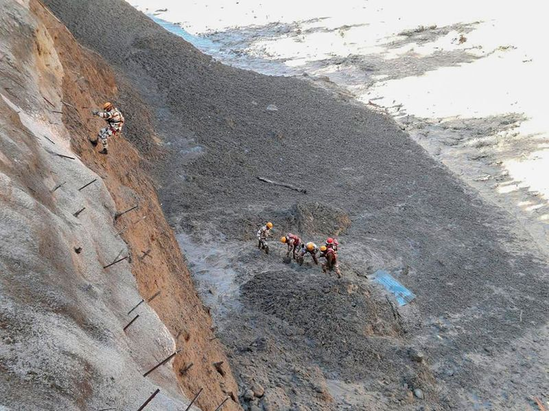 his photograph provided by Indo Tibetan Border Police (ITBP) shows ITBP personnel begin rescue work after a portion of Nanda Devi glacier broke off in Tapovan area of the northern state of Uttarakhand sending a massive flood of water, mud and debris into areas below, India, Sunday, Feb.7, 2021