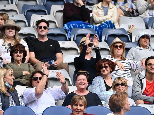 Fans watch the first round match between Canada's Bianca Andreescu and Romania's Mihaela Buzarnescu.