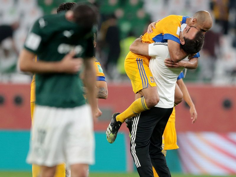 Tigres players celebrate Club World Cup 2020 semifinal win as Palmeiras mourn their loss.