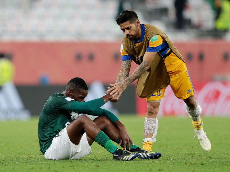 Tigres players console Palmeiras after history-making win at Club World Cup 2020.