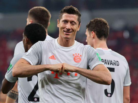 Bayern Munich's Polish forward Robert Lewandowski celebrates his second goal during the FIFA Club World Cup semi-final football match between Egypt's Al-Ahly and Germany's Bayern Munich at the Ahmed bin Ali Stadium in the Qatari city of Ar-Rayyan on February 8, 2021. (Photo by Karim JAAFAR / AFP)