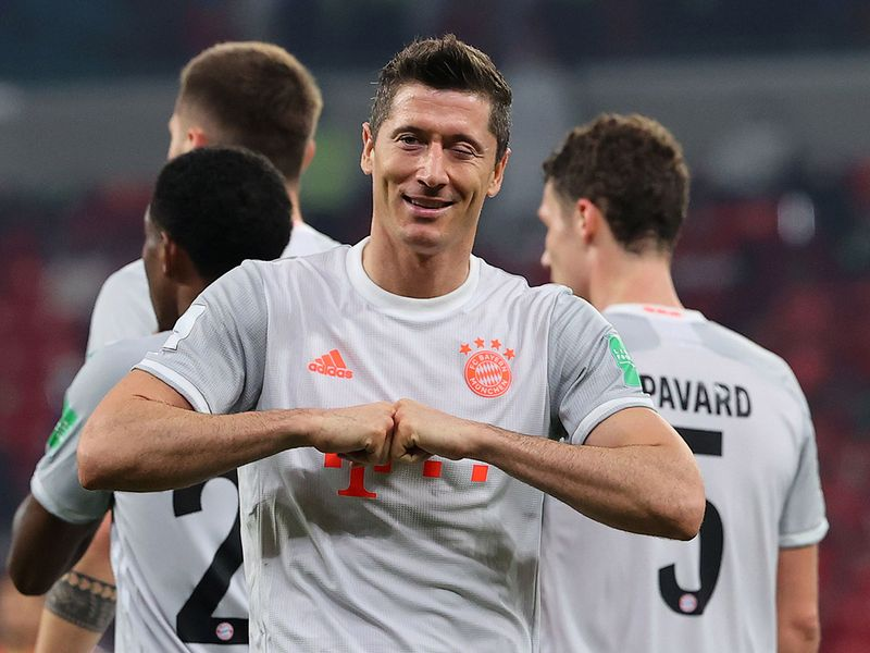 Bayern Munich's Polish forward Robert Lewandowski celebrates his second goal during the FIFA Club World Cup semi-final football match between Egypt's Al-Ahly and Germany's Bayern Munich at the Ahmed bin Ali Stadium in the Qatari city of Ar-Rayyan on February 8, 2021. (Photo by Karim JAAFAR / AFP)