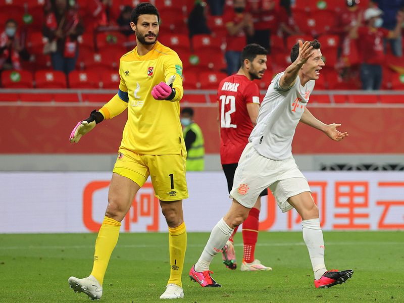 Bayern Munich's Polish forward Robert Lewandowski reacts after a challenge by Ahly's goalkeeper Mohamed Al Shenawy during the Fifa Club World Cup semi-final.