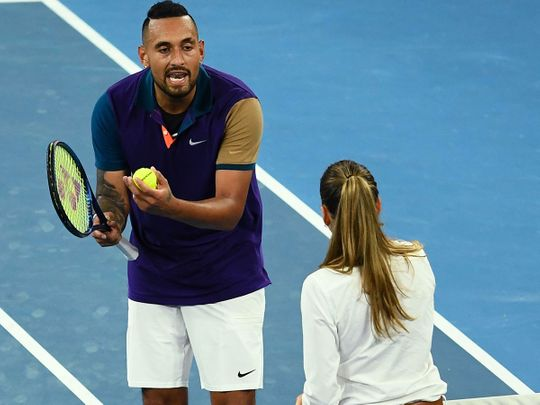 Australia's Nick Kyrgios talks to the umpire as he plays against France's Ugo Humbert during their men's singles match on day three of the Australian Open