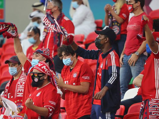 Bayern Munich supporters cheer during the Fifa Club World Cup semi-final against Egypt's Al-Ahly at the Ahmed bin Ali Stadium in the Qatari city of Ar-Rayyan