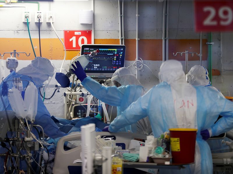 Medical workers, seen through a window of an observation room, as they work inside an underground ward treating COVID-19 patients at the Critical Care Coronavirus Unit at Sheba Medical Center in Ramat Gan, Israel.