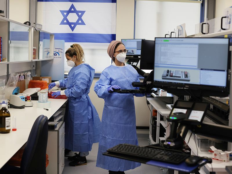 Technicians work at Healthcare Maintenance Organisation (HMO) Maccabi's COVID-19 public laboratory, performing diverse and numerous tests, in Rehovot, Israel.