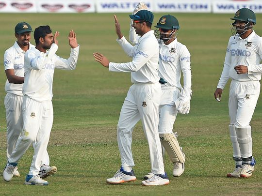 Bangladesh's cricketers celebrate after the dismissal of West Indies' Shayne Moseley