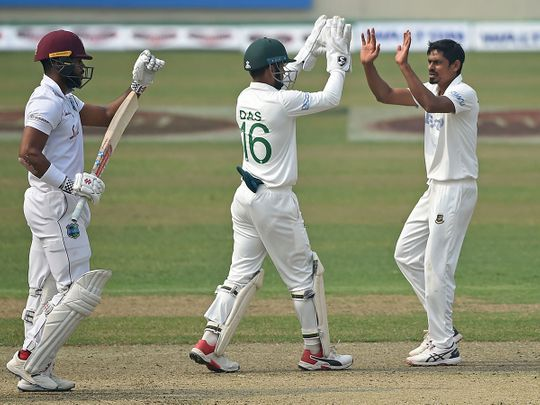 Bangladesh's Taijul Islam (R) with wicketkeeper Liton Das celebrate after the dismissal of West Indies' John Campbell (L) in Dhaka