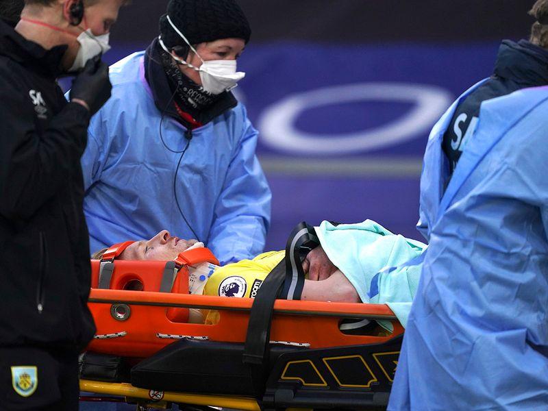 Burnley captain Ben Mee stretchered off.