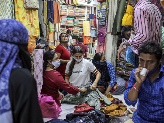 Customer browse fabrics inside Mangaldas Market in Mumbai.