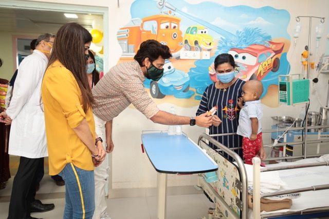 Riteish Deshmukh and Genelia D'Souza with children at a cancer ward in Mumbai on February 15, 2021
