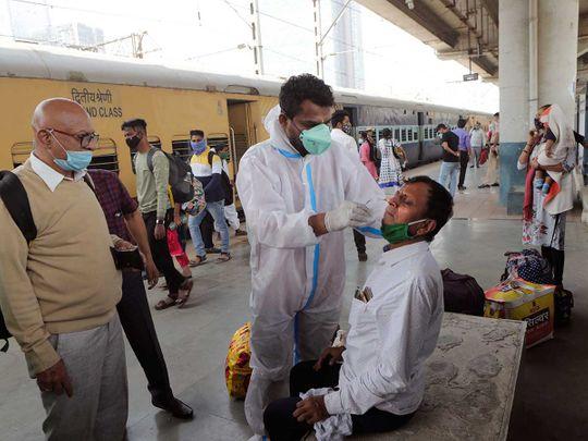 India covid test health worker sample railway station Mumbai