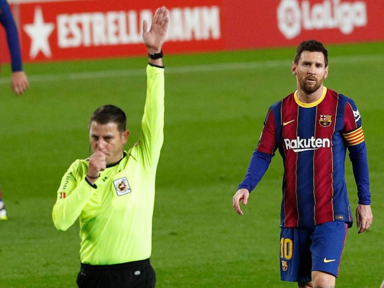 Messi and referee.
