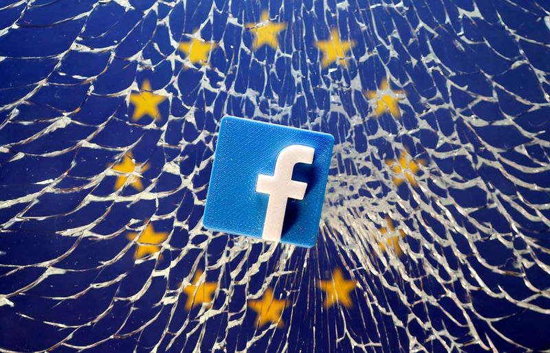 FILE PHOTO: A 3D printed Facebook logo is placed on broken glass above a printed EU flag in this illustration taken January 28, 2019.