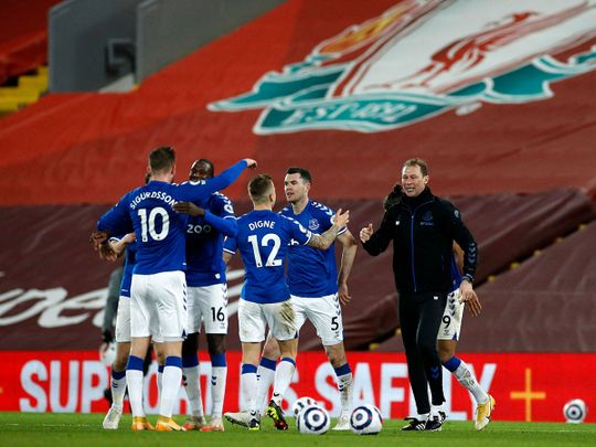 Everton's assistant manager Duncan Ferguson celebrates with his team after the win over Liverpool