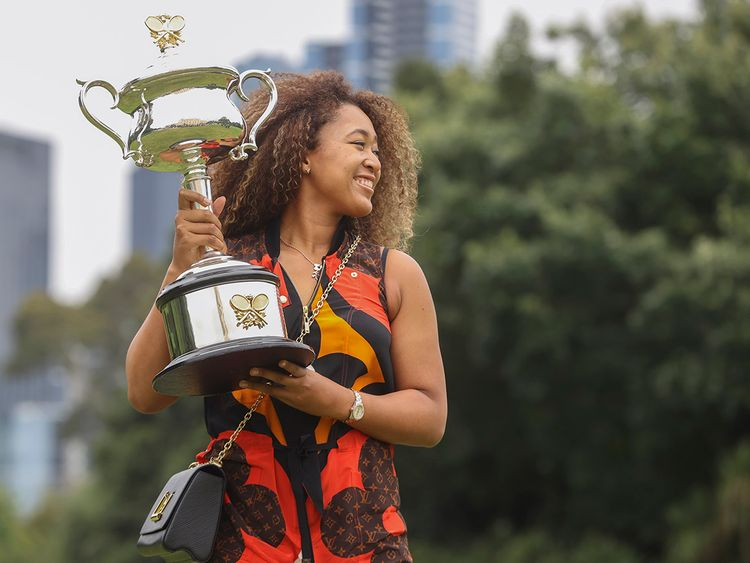 Naomi Osaka poses with her Australian Open trophy on February 21, 2021.